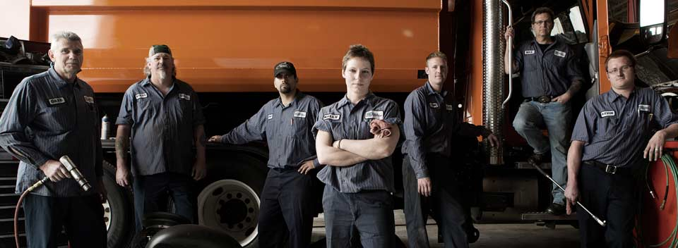Image of Automotive workers by truck