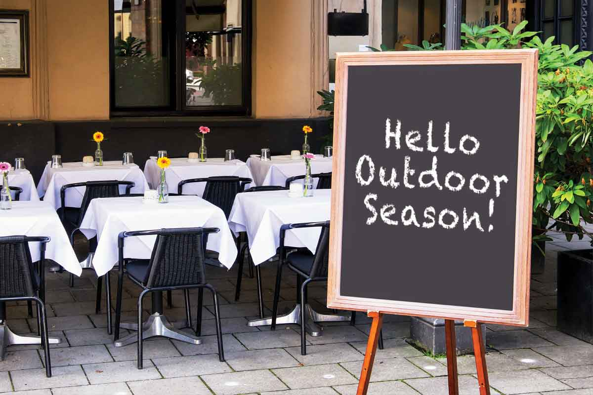 image of outdoor restaurant with table cloth linen