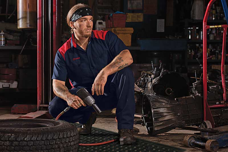 image of auto mechanic working with towels and mats