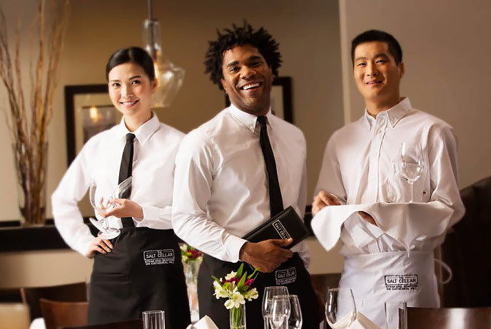 Image of food servers wearing uniforms